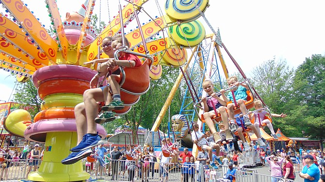 Sponsored by the McLean Community Center, McLean Day is held on the third Saturday in May. The Lolly Pop Swing at McLean Day 2019.