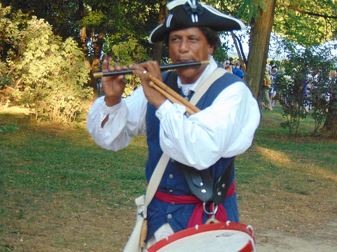 """Don Francisco, in traditional costume, part of """"Patriotic Fife, Flute, Whistle, Panpipes & Drum: A historical musical presentation."""""""