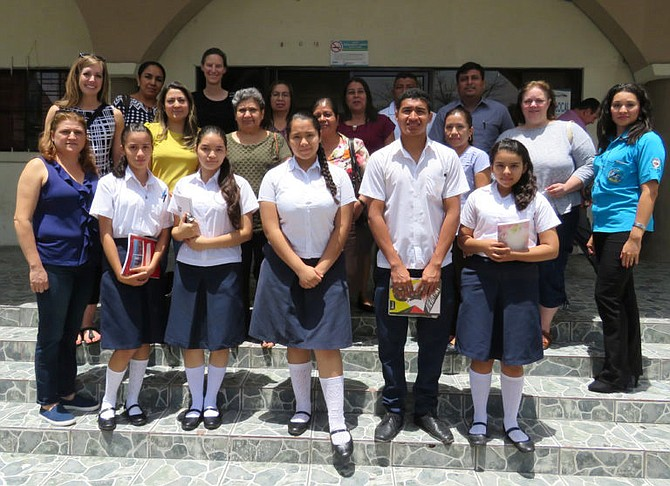 Staff from T.C. Williams High School's International Academy visited schools in El Salvador in June.