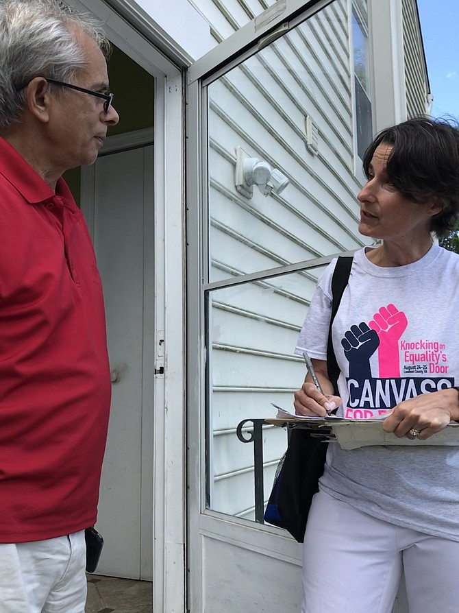Virginia Sen. Jennifer Boysko (D-33) speaks with a constituent in her district, Krishna Khanal of the Town of Herndon, during the Aug. 24-25 Canvass for Equality.