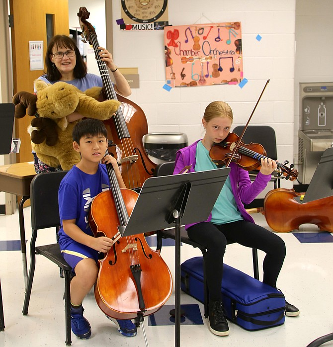 Ruth Donahue, music teacher, with her students, violinist Jolie Korfonta and cellist Daniel Kim.