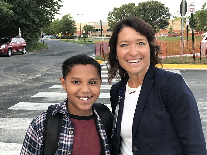 Aimee Monticchio, Principal of Langston Hughes Middle School, greets a new student, Natnal Erko, 12, of Reston on the first day back to school 2019.