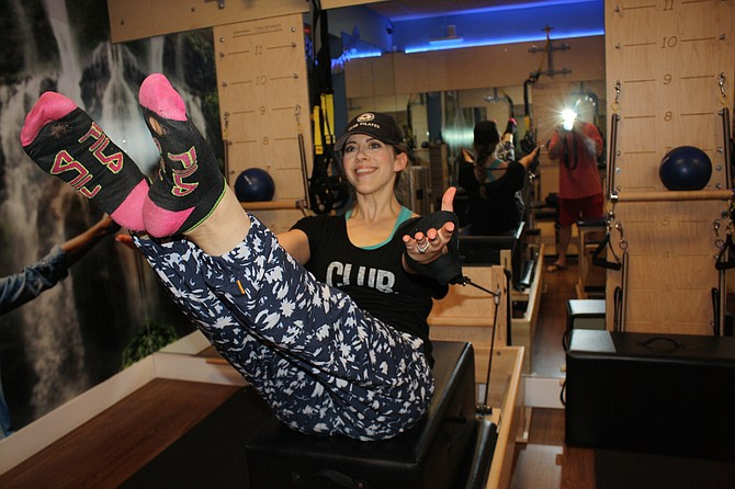 Strength and smiles while doing Pilates.