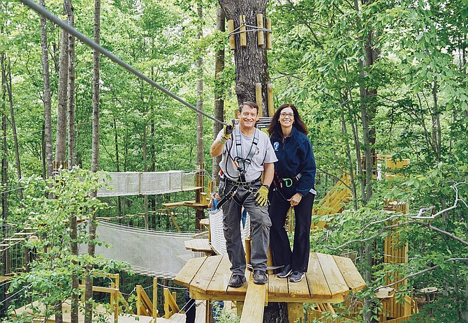 Supervisor Pat Herrity enjoys the GoApe Course at South Run REC Center.