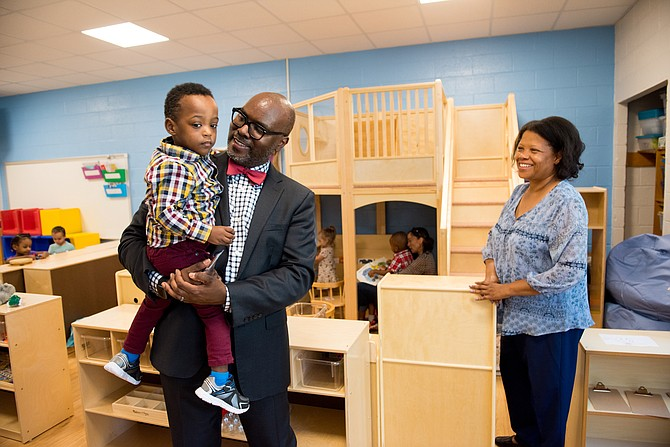 Superintendent Gregory C. Hutchings, Jr. comforts a student experiencing a little separation anxiety at the Early Childhood Center at John Adams Elementary School.