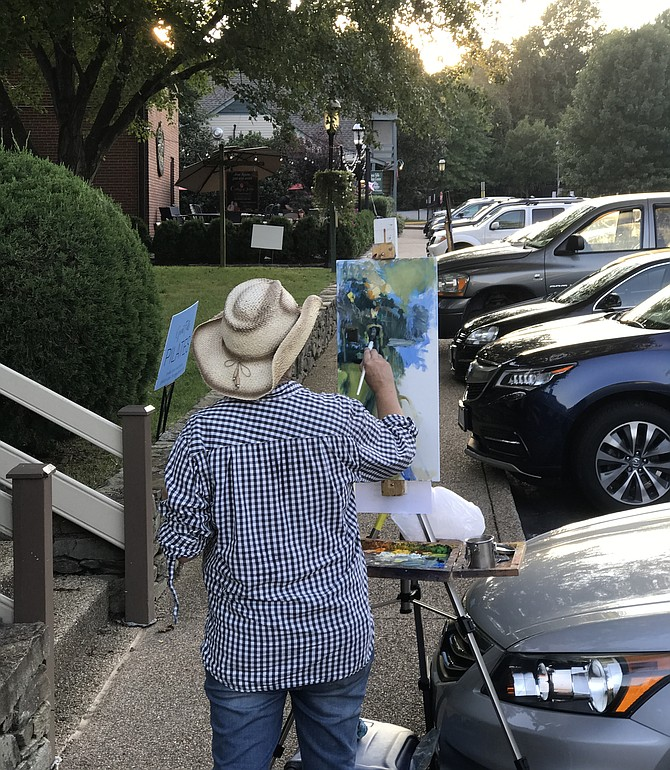 """Artist Jill Banks, 2018 Paint Great Falls 1st Place Winner, paints in """"plein air"""" in the Village Centre."""