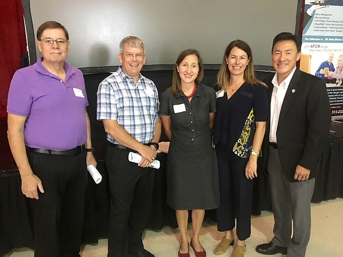 Pictured taking a break during the Clergy Breakfast are (from left): Rev Jeffrey Haugh, Vale United Methodist Church; Rev. Donald Ferris-McCann, Bruen Chapel United Methodist Church; Rev. Kristen McBrayer, Emmaus UCC;  Vienna Mayor Laurie DiRocco; and Del. Mark Keam, (D-35).