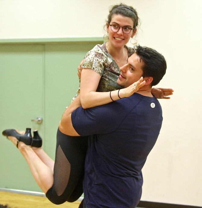 "Robin Weiner (Belle) and Joseph Aquelina (Gaston) rehearse a scene from ""Disney's Beauty and the Beast."""