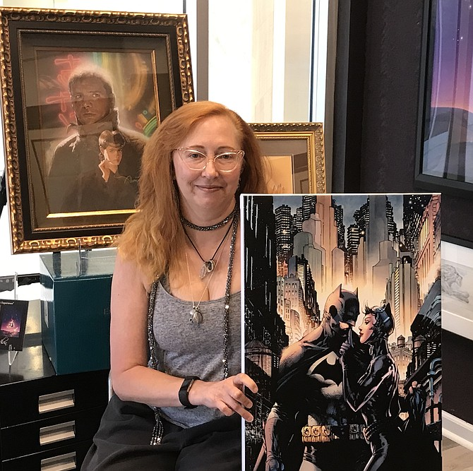 After creating and moderating her eight-person panel, Women Rocking Hollywood 2019: Women-powered Projects and the Push Towards Parity for the 2019 Comic-Con International in San Diego (Comic-Con), Leslie Combemale enjoys a moment at the gallery she co-owns and operates, ArtInsights Gallery of Film and Contemporary Art in Reston Town Center.