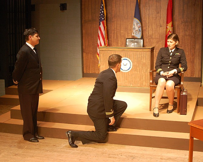 "From left to right: Jonathan Mulberg (Lt. J.G. Sam Weinberg), Brendan Quinn (Lt. J.G. Daniel Kaffee), and Emma Wesslund (Lt. Cmdr. Joanne Galloway) star in ""A Few Good Men."""