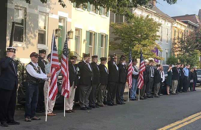 Members of the American Legion, Patriot Guard Riders and others salute the arrival of the remains of MSG Jose J. Gonzalez Sept. 10 in Old Town.
