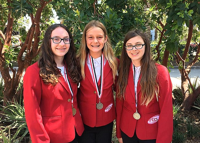 From left are STAR award winners Emily Sarber, Fairfax High sophomore; and Lanier Middle School eighth-graders Caitlyn Clark and Sierra Warden.