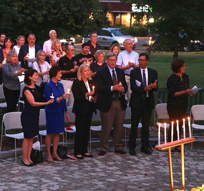 From left: State Sen. Barbara Favola; Chairman of the Fairfax County Board of Supervisors Sharon Bulova; Del. Kathleen Murphy; Dranesville District Supervisor John Foust; and former Great Falls resident and CNN Washington Bureau Chief Frank Sesno lit the candles to honor the lives that were lost on 9/11.