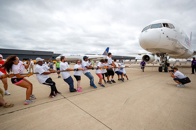 The Fairfax County Police Unified Team 2 pulls an 82-ton FedEx Airbus A320.