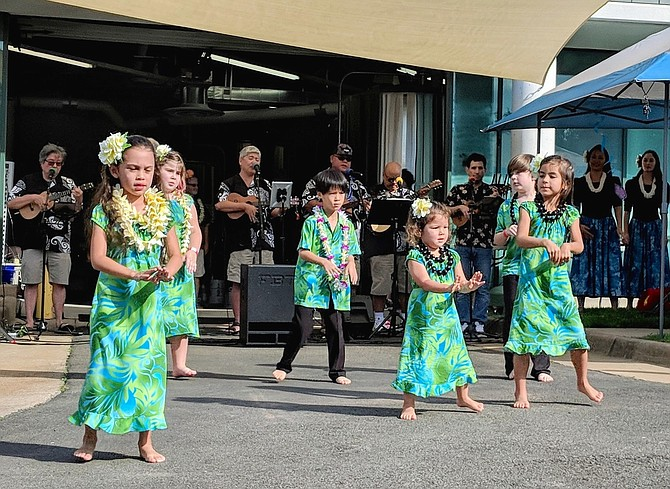 Children performing the hula at last year's anniversary.