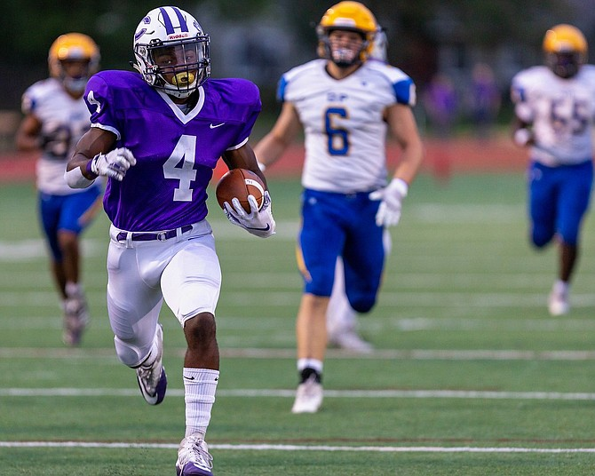Chantilly RB Darius Clark #4  outruns the defense of Osborn Park enroute to his first of two touchdowns.