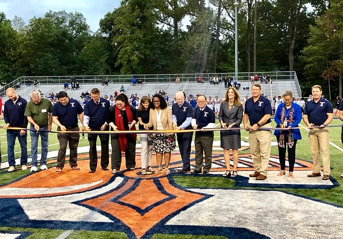 Elected officials and school community celebrate ribbon-cutting on renovations at the West Springfield High School.