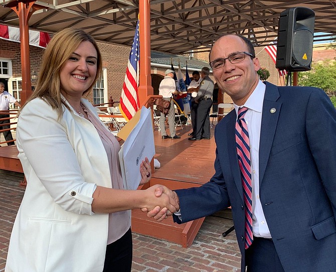 Malsha Arzana of Kosovo is congratulated by Mayor Justin Wilson after becoming a U.S. citizen Sept. 10 in Market Square.