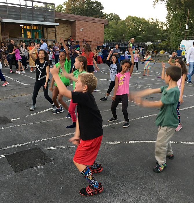 Students dance to music by Deejays Freddy, Chris and Bam Bam of Glide Productions at the Potomac Elementary Back to School Picnic Friday.