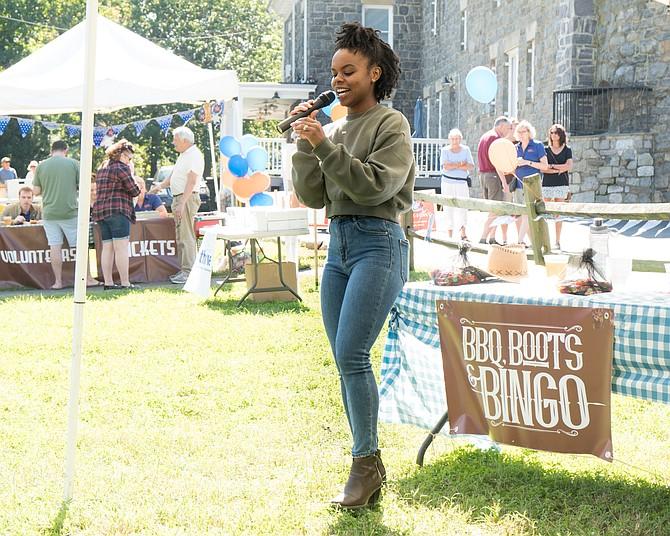 Thrive board member Jasmine Rogers calls bingo at the Thrive barbecue last year.