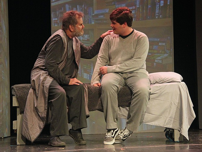 "Paul Donahoe (The Giver) and Bret Medley (Jonas) rehearse a scene from ACCT's production of ""The Giver,"" which will be produced from Sept. 27-Oct. 13, 2019."