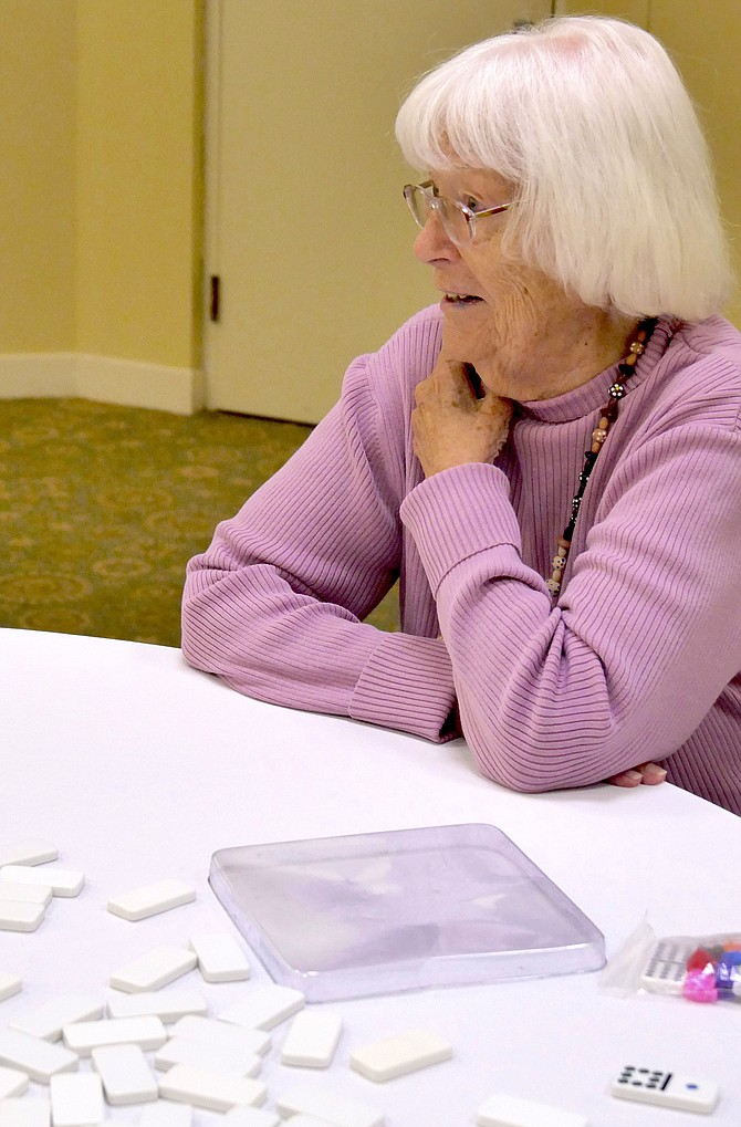 Ninety-six-year-old Eva Sorensen from Alexandria is the oldest competitor in Mexican train dominoes in this year's Northern Virginia Senior Olympics, held at Goodwin House.
