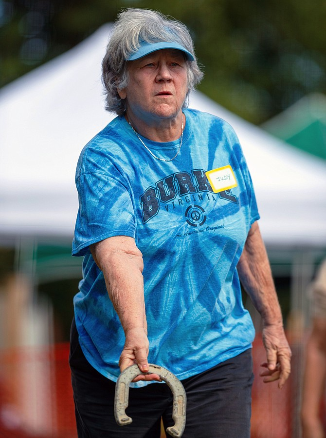 Judy Landolt-Korns of Clifton prepares to throw during the horseshoes competition. Landolt-Korns won a gold medal.