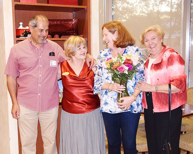 Star Nut Gourmet owners and Woman's Club officers enjoy the event. From left: Café owner Joe Shehadeh, Homes Tour chairman Kathryn Mackensen, Star Nut owner Denise Shehadeh, and Woman's Club President Cecilia Glembocki.