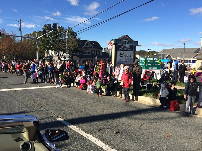 People line up to see the Potomac Day Parade. Potomac Day is Saturday, Oct. 12.