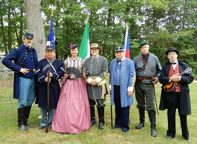 Wearing period dress for the remembrance ceremony at Ox Hill Battlefield Park are (from left) John Myers, Mario Lucero, Debbie and Mark Whitenton, Drew Pallo, Patrick Sullivan and Jon Vrana.