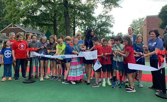 Mount Vernon Community School students, PTA members and ACPS officials celebrated the opening of the Mount Vernon Play Garden with a ribbon cutting ceremony Sept. 6.