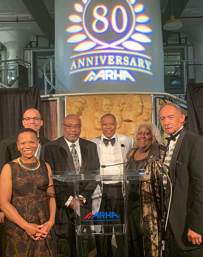 Erika Miller, Mayor Justin Wilson, Bill Euille, ARHA CEO Keith Pettigrew, Michelle Chapman and Roy Priest pose for a photo after each offered remarks in celebration of the 80th anniversary of ARHA Sept. 28 at the Torpedo Factory Arts Center.