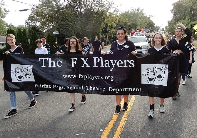 The school's theater department marches along.
