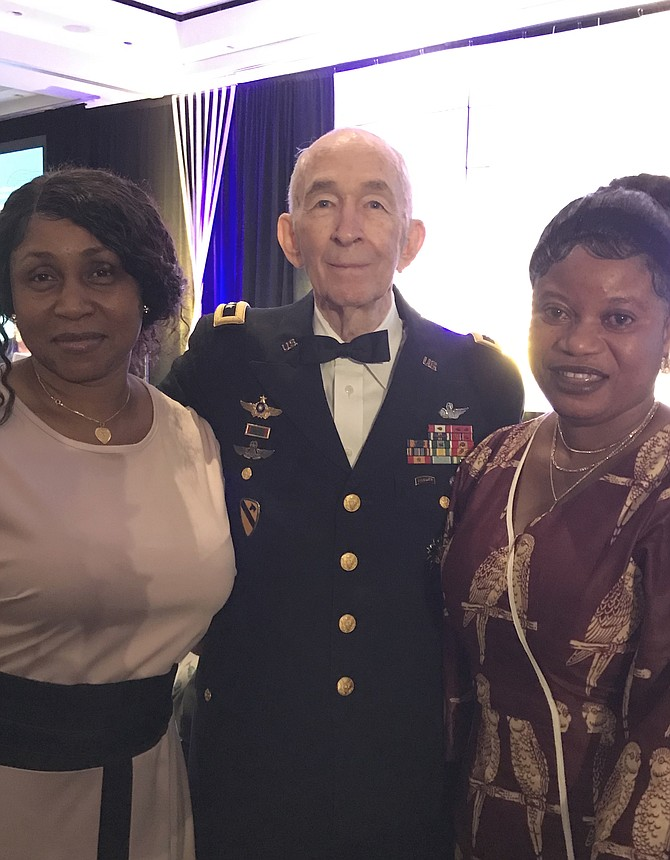Major General Carl H. McNair Jr. (RET) joins his tablemates, Saffiatu Janneh and Kadiatu Kamara, before the start of 2019 Raise the Region Gala produced by The Community Foundation for Northern Virginia held at the Hilton McLean Tysons Corner on Friday evening, Oct. 4.