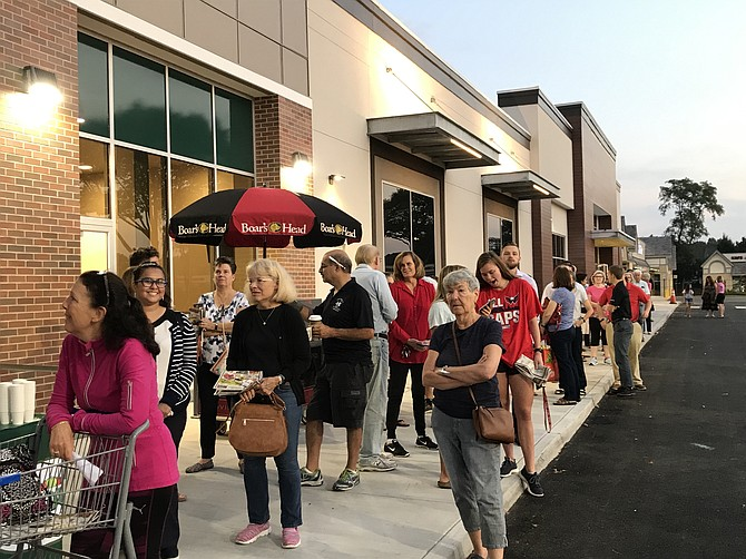 Sprouts' first customers line up in Herndon ready to experience 20,000 products, 2,400 of which are private label or Sprouts brand.