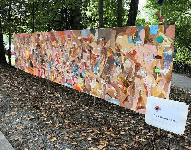 A mural painted by students at the Potomac School greets visitors along the main pathway.