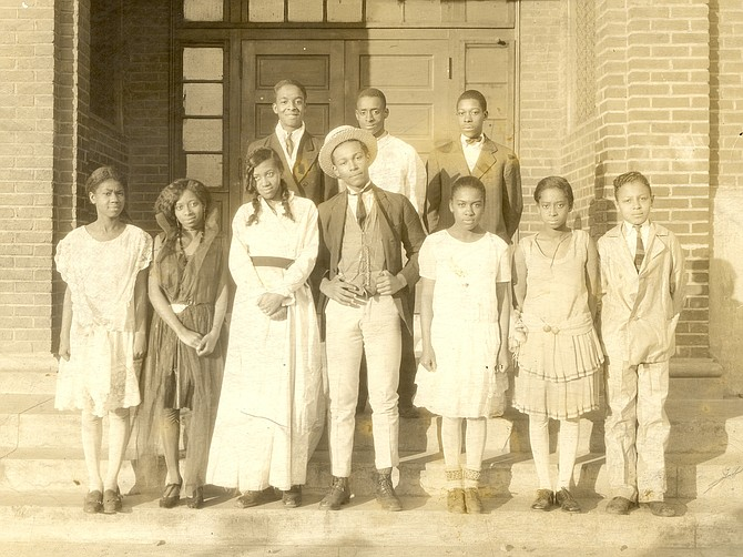 A 1927 Parker-Gray School play; Joseph C. Waddy is standing in the front row with the hat on his head.