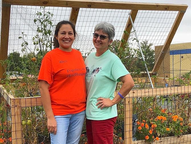 Gardeners Pamela Montesinos and Barbara Seng.