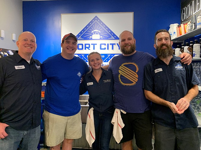 Port City Brewing Company bartenders Chad Droz, Emma Quinn, Tim Quintun and Justin Fox are ready to serve varieties of beer at the Sept. 26 Oktoberfest benefitting the Campagna Center.
