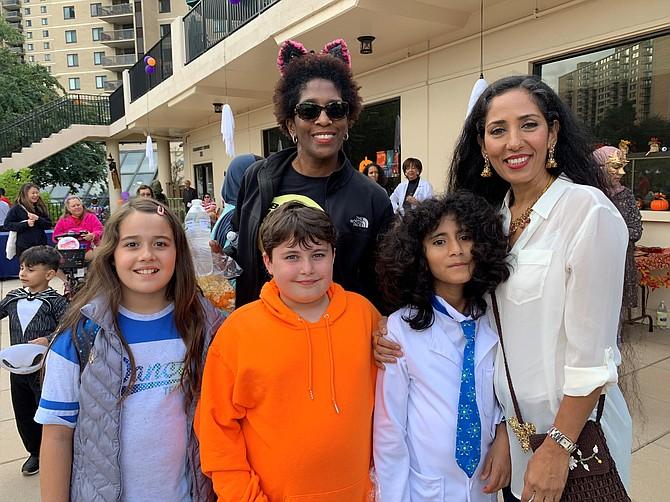 Spooky Mad Science Expo organizer Zohreh Khoshnamak, right, with Shadia Mohmmadi and brother Samyar, Nikpirouz Khoshnamak and Tara Jackson, in back, Oct. 5 at The Watergate at Landmark.