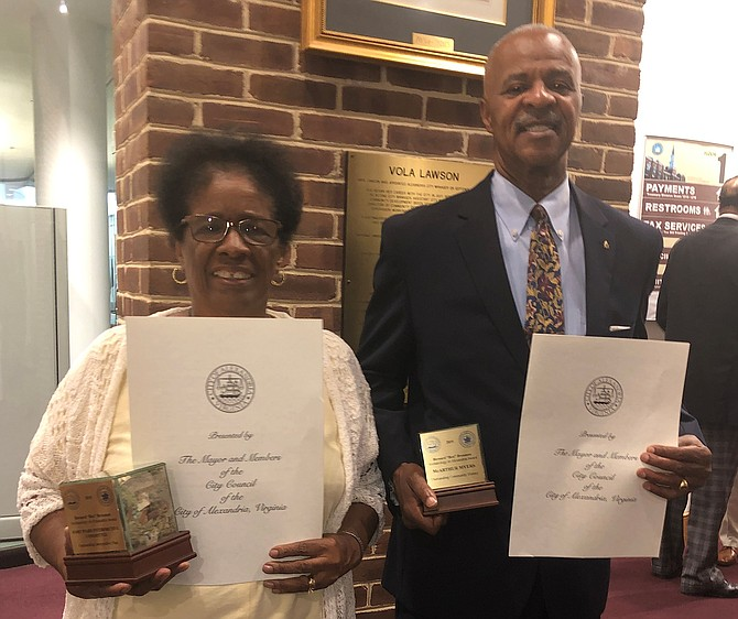 Frances Terrell, a member of the Fort Ward Interpretive Committee, and McArthur Myers, hold the Ben Brenman awards following a presentation by City Council and the Alexandria Archeological Commission Oct. 2 at City Hall.