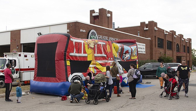 Children enjoy the bouncy house out in front of the fire station.