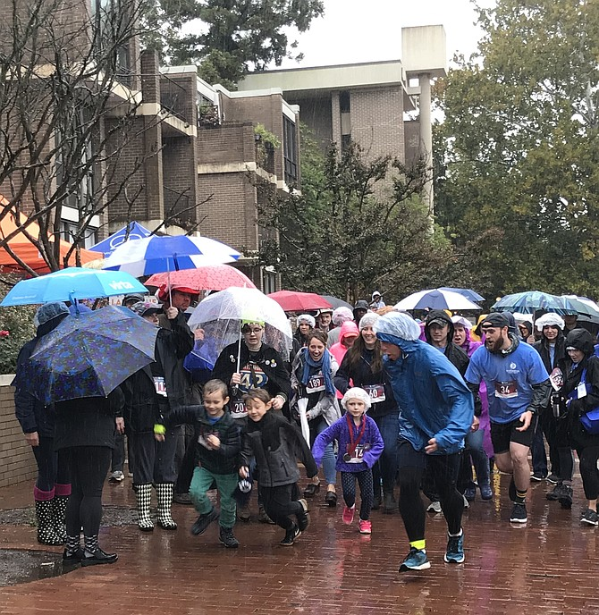 And they're off at the 2nd Annual Do It Your Way 0.5k, 'raining' funds for the SLHS PTSA Food Pantry. Final fund tallies revealed a stunning $18,000 raised to fight food insecurity experienced by students in the South Lakes High School Pyramid.