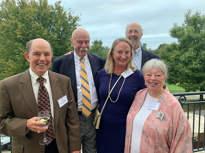 Enjoying the Belle Haven Country Club terrace during the Oct. 6 At Home Alexandria gala are Barry Stauffer, Tom Crowley, Rollie Frye, Christena Nielsen and Susan Pettey.