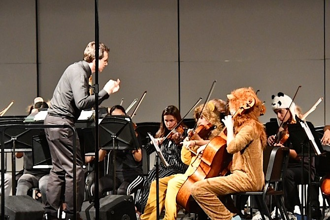 Conductor Dr. Scott McCormick directs the wild animals during the orchestra performance.