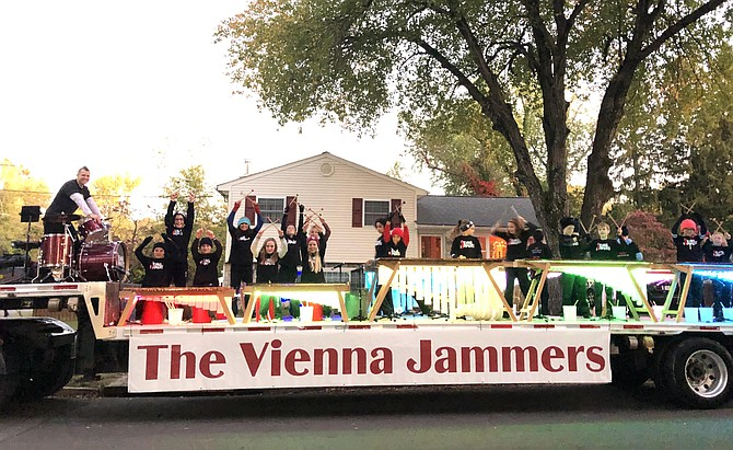 The Vienna Jammers play their instruments on a giant truck bed.