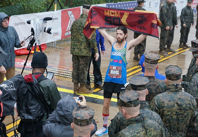 Arlington's Michael Wardian celebrates winning the inaugural Marine Corps Marathon 50K race Oct. 27 in Arlington. A world-renowned ultra distance runner, Wardian, 45, completed the course in 3:11:52.
