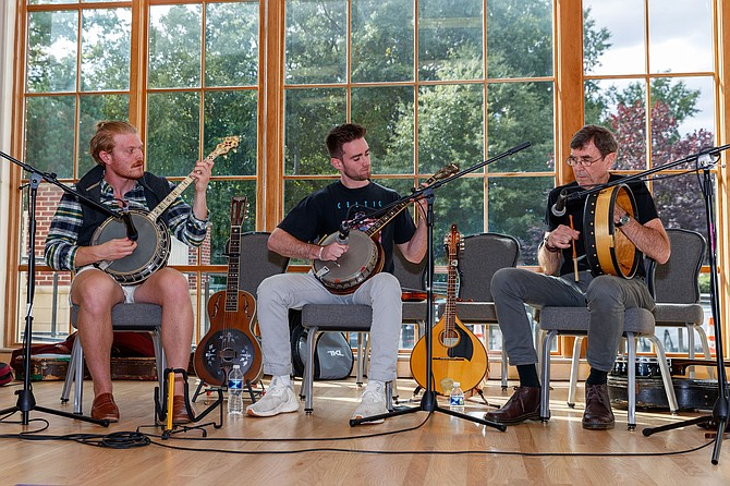 """From left, Brendan Coyne, Patrick Winch, and Jesse Winch perform """"Trip to Miriam's"""" on the Clare Stage."""