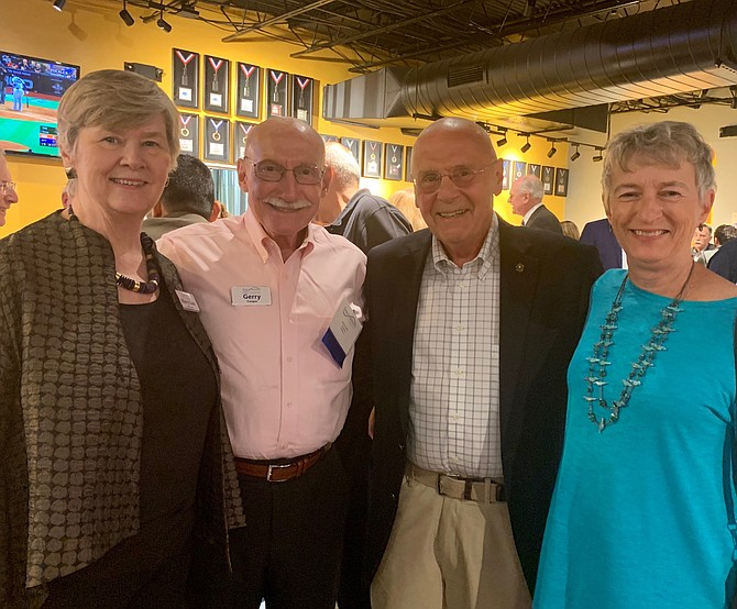 Senior Services of Alexandria Executive Director Mary Lee Anderson, left, poses for a photo with Gerry Cooper and Patrick and Bobbi O'Brien at the annual SSA Oktoberfest Oct. 15 at Port City Brewing Company.