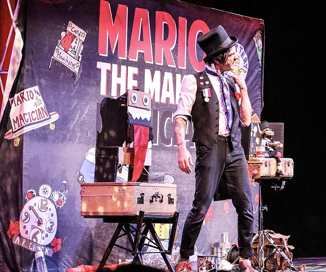 Mario the Maker Magician performs on stage.